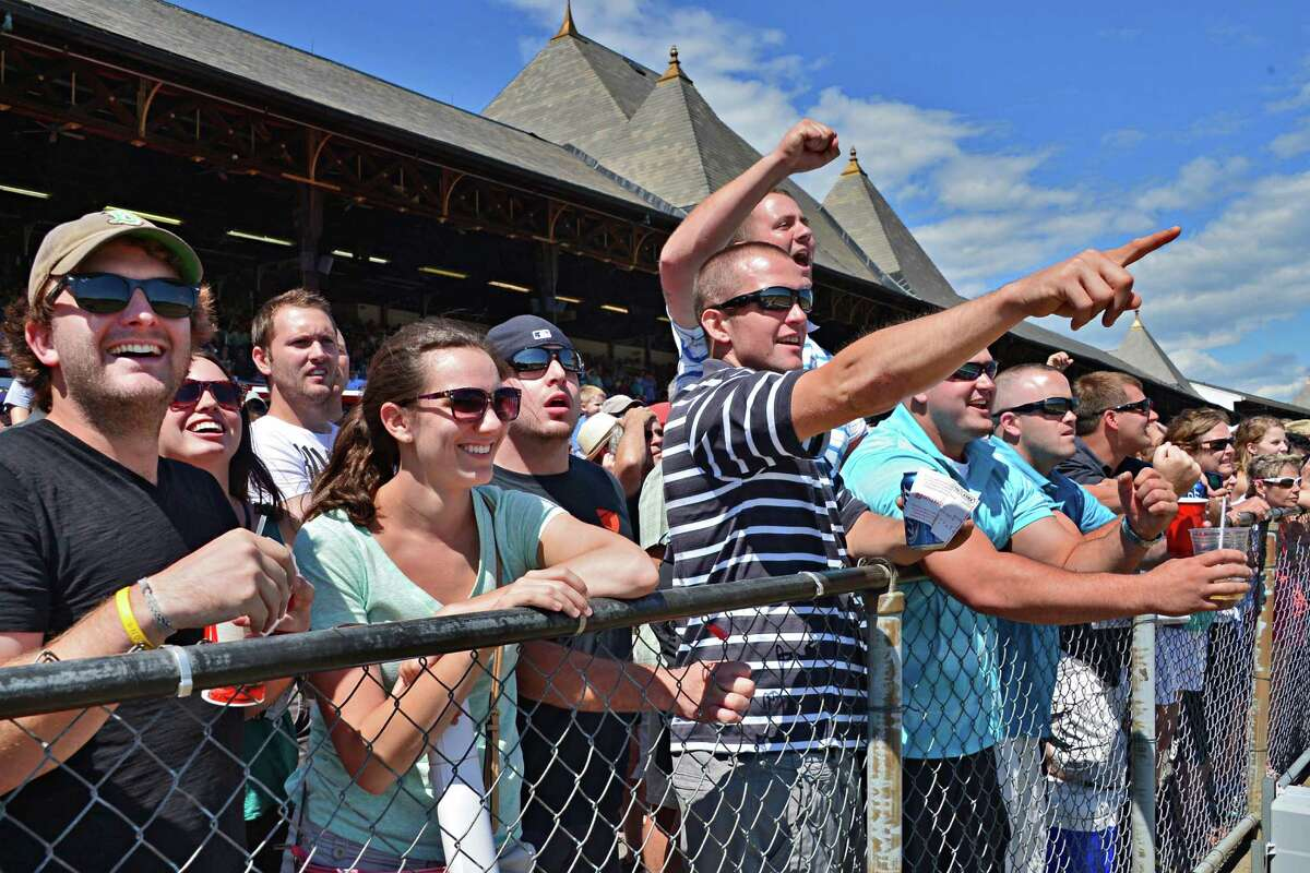 Railbirds cheer on their picks in the fourth race at Saratoga Race Course Saturday, Aug. 3, 2013, in Saratoga Springs, N.Y. (John Carl D'Annibale / Times Union)