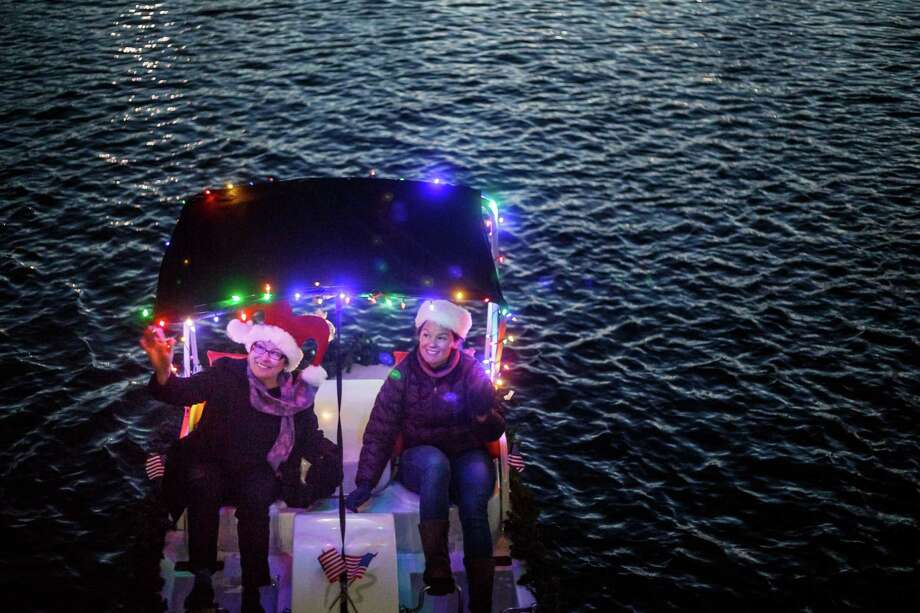 Former Navy helicopter pilot Katie Baehr, right, and her mom Lydia enjoy a paddleboat at Hermann Park.  The Baehrs installed their own lights tto continue a family tradition Katie missed while flying missions in the Middle East. Photo: Michael Paulsen, Staff / © 2013 Houston Chronicle