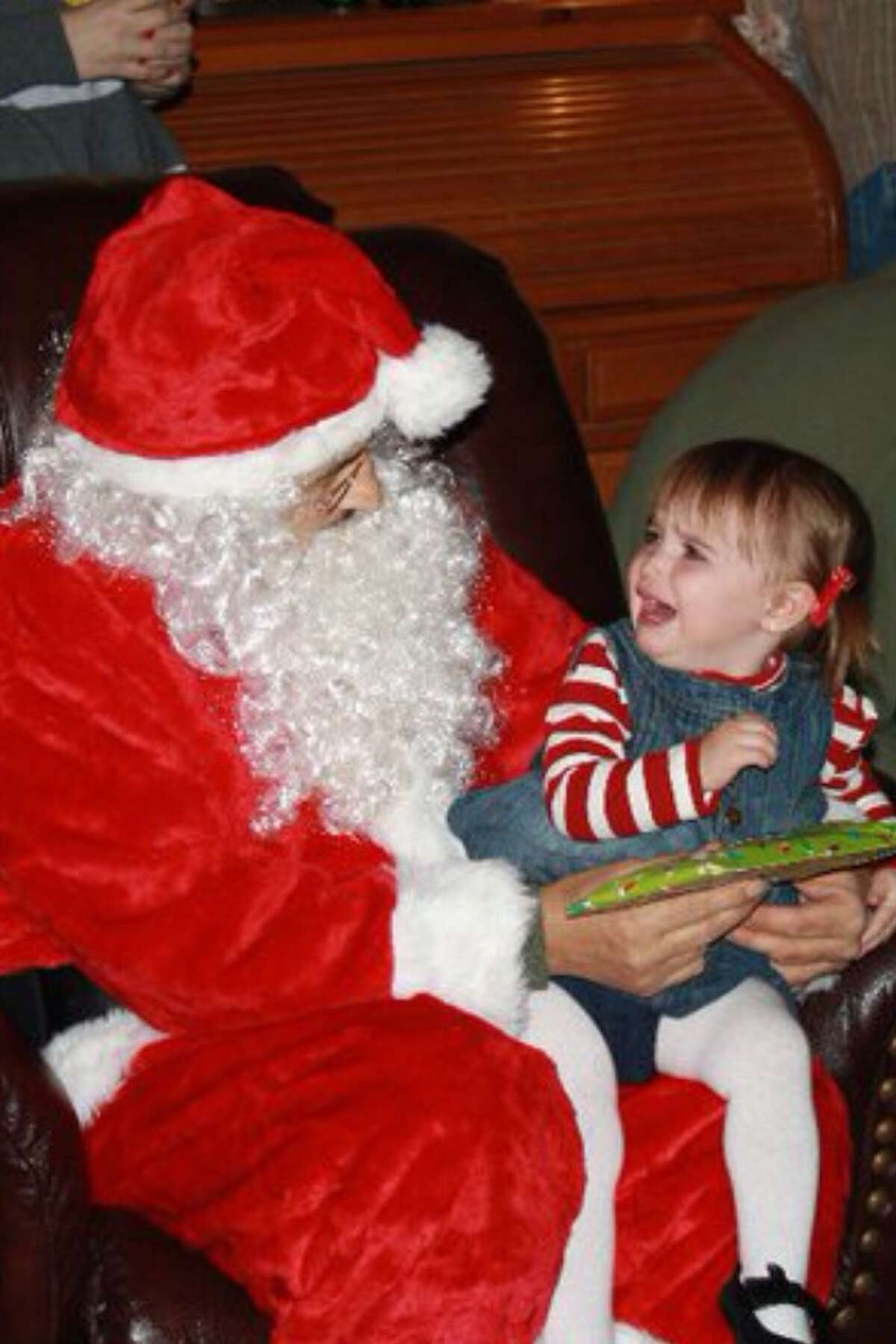 Two-year-old Emma Rogers was terrified of Santa Claus.