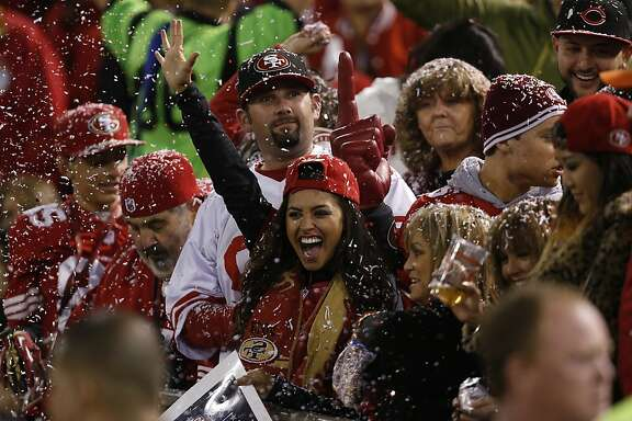 Fans celebrate during the first quarter of the game between the San Francisco 49ers and Atlanta Falcons at Candlestick Park on Monday December 23, 2013 in San Francisco, Calif.