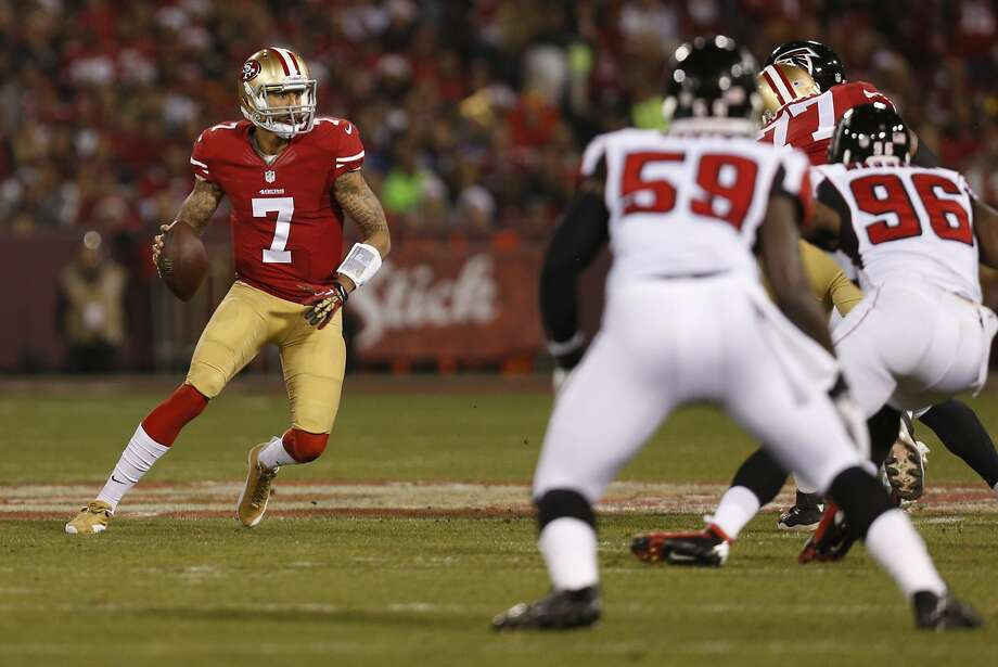 San Francisco 49ers quarterback Colin Kaepernick (7) scrambles during the first quarter of the game between the San Francisco 49ers and Atlanta Falcons at Candlestick Park on Monday December 23, 2013 in San Francisco, Calif. Photo: Michael Macor, The Chronicle
