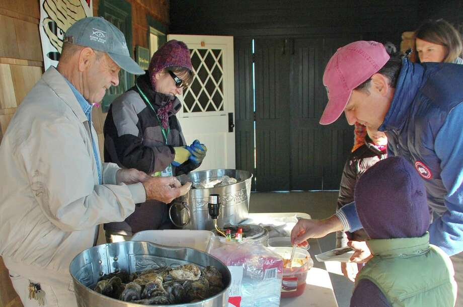 On Jan. 5, from 1:30 to 4 p.m. at Greenwich Point Park, the Greenwich Shellfish Commission leads a family-oriented, hands-on program about oysters, clams and harvesting shellfish. The presentation is part of the First Sunday Science program at the Seaside Center. For more information call weekdays 203-413-6756. Above, visitors sample shellfish at the Seaside Center. Photo: Contributed Photo / Greenwich Citizen