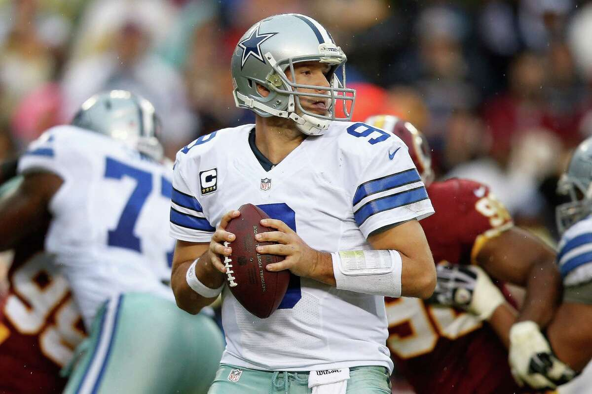 Dallas Cowboys quarterback Tony Romo looks for an opening to pass during the second half of an NFL football game against the Washington Redskins in Landover, Md., Sunday, Dec. 22, 2013. (AP Photo/Evan Vucci) ORG XMIT: FDX123