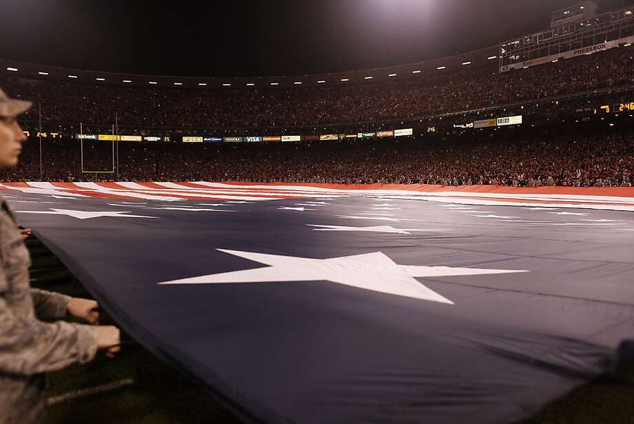 Air Force personnel hold a large flag during the singing of the National Anthem on the field before a 49ers game against the Atlanta Falcons at Candlestick Park on December 23, 2013 in San Francisco, Calif. This will be the last regular-season game at Candlestick Park. Photo: Pete Kiehart, The Chronicle