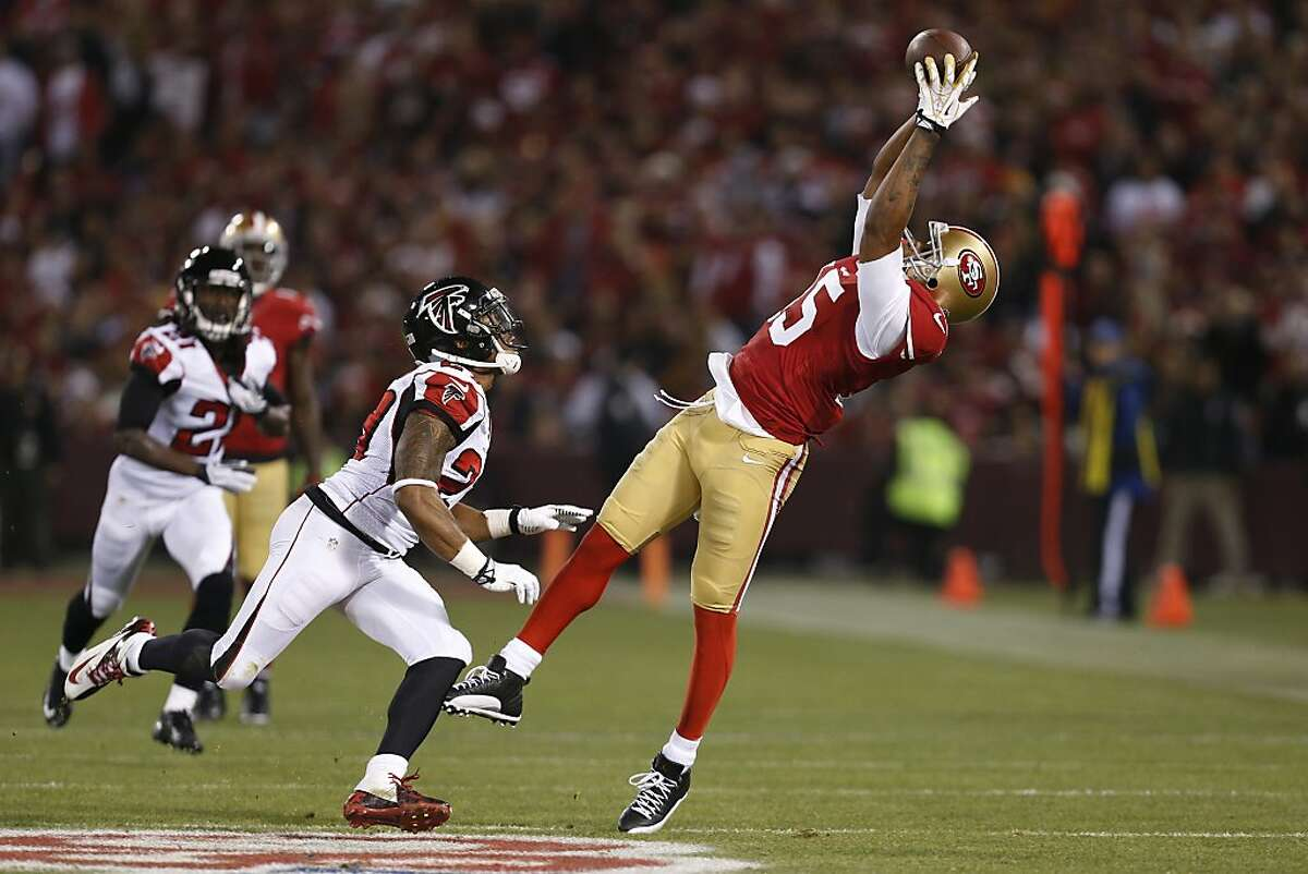 San Francisco 49ers wide receiver Michael Crabtree (15) catches a pass during the first quarter of the game between the San Francisco 49ers and Atlanta Falcons at Candlestick Park on Monday December 23, 2013 in San Francisco, Calif. The play was negated due to offensive pass interference.