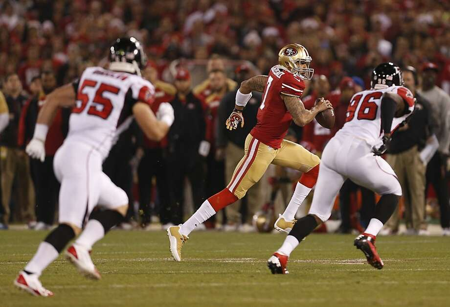 San Francisco 49ers quarterback Colin Kaepernick (7) scrambles out of the pocket chased by Atlanta Falcons defensive end Jonathan Massaquoi (96) and Paul Worrilow on Monday, Dec. 23, 2013 at Candlestick Park in San Francisco, Calif. Photo: Beck Diefenbach, For The Chronicle