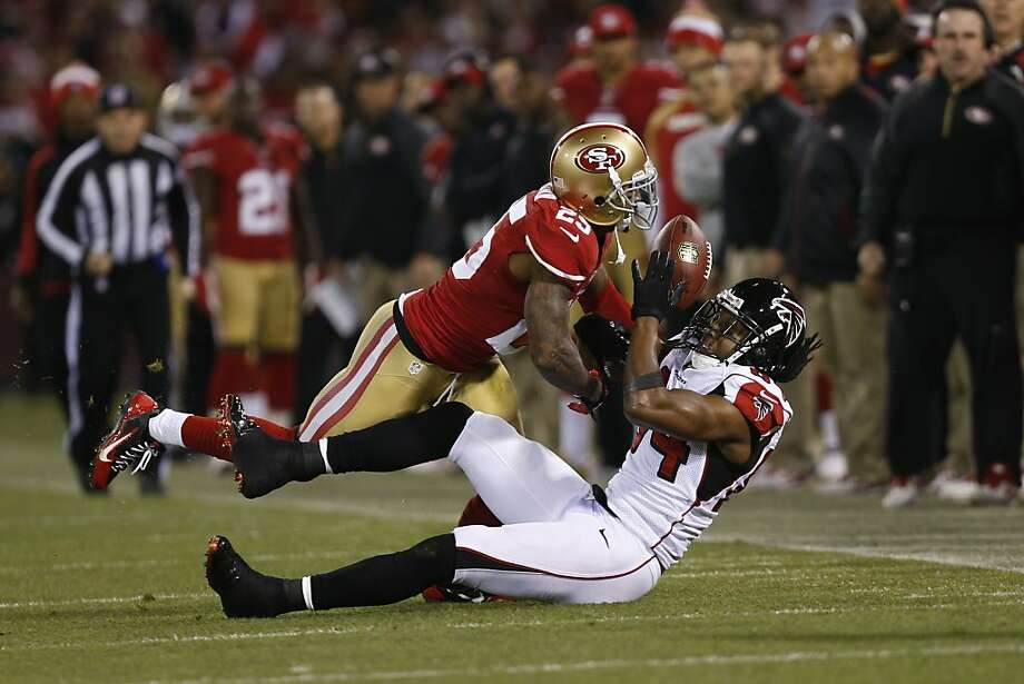 Atlanta Falcons wide receiver Roddy White (84) and San Francisco 49ers cornerback Tarell Brown (25) wrestle for a pass that fell incomplete during the first quarter of the game between the San Francisco 49ers and Atlanta Falcons at Candlestick Park on Monday December 23, 2013 in San Francisco, Calif. Photo: Michael Macor, The Chronicle