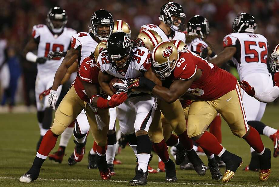 Atlanta Falcons running back Jacquizz Rodgers (32) is gang tackled by San Francisco 49ers Anthony Dixon (24) and San Francisco 49ers defensive end Tony Jerod-Eddie (63) during the first quarter of the game between the San Francisco 49ers and Atlanta Falcons at Candlestick Park on Monday December 23, 2013 in San Francisco, Calif. Photo: Michael Macor, The Chronicle