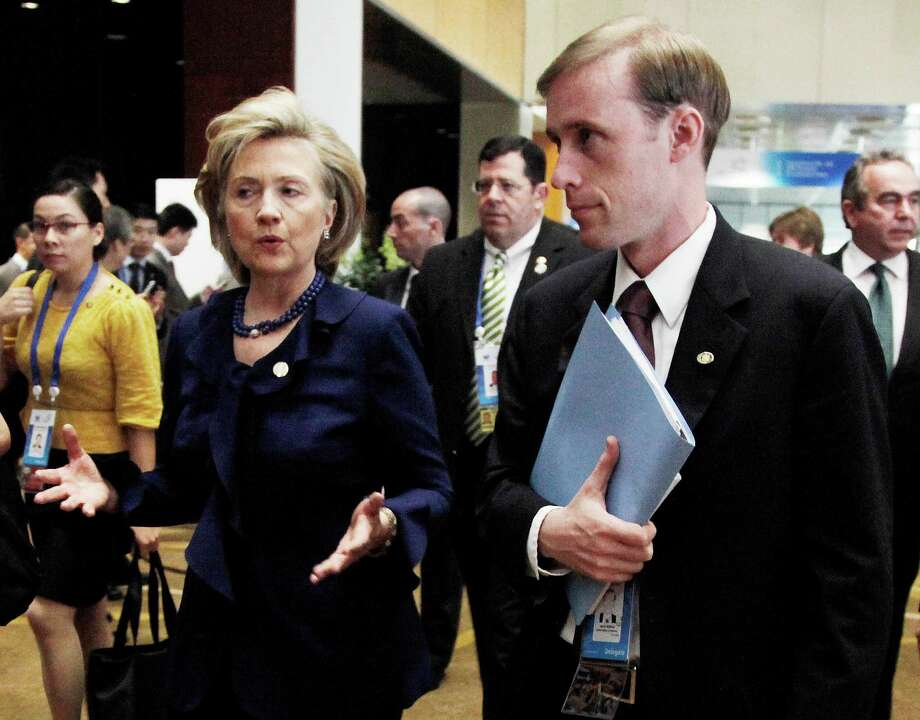 FILE - This Nov. 11, 2009 file photo shows then-Secretary of State Hillary Rodham Clinton walking with a then-Deputy Chief of Staff Jake Sullivan in Singapore. Last summer, Sullivan was traveling with his boss, Hillary Rodham Clinton, when he suddenly disappeared during a stop in Paris. He showed up again a few days later, rejoining Clinton's traveling contingent in Mongolia. In between, Sullivan secretly had jetted to the Middle Eastern nation of Oman to meet with officials from Iran, people familiar with the trip said. The July 2012 meeting is one of the Obama administration's earliest known face-to-face contacts with Iran and reveals that Sullivan _ who moved from the State Department to the White House earlier this year _ was personally involved in the administration's outreach to the Islamic republic far earlier than had been reported.  (AP Photo/Ng Han Guan, File) ORG XMIT: PACE Photo: Ng Han Guan / AP