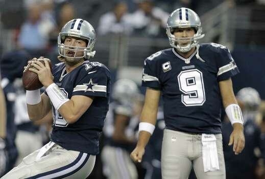 Dallas Cowboys quarterbacks Kyle Orton (18) and Tony Romo (9) warm up before an NFL football game, Thursday, Nov. 28, 2013, in Arlington, Texas.  (AP Photo/Brandon Wade) Photo: Brandon Wade, Associated Press / FR168019 AP