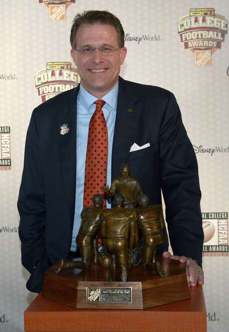 Auburn head coach Gus Malzahn poses with The Home Depot Coach of the Year Award after winning the honor during the College Football Awards show in Lake Buena Vista, Fla., Thursday, Dec. 12, 2013.(AP Photo/Phelan M. Ebenhack) Photo: Phelan M. Ebenhack, FRE / FR121174 AP