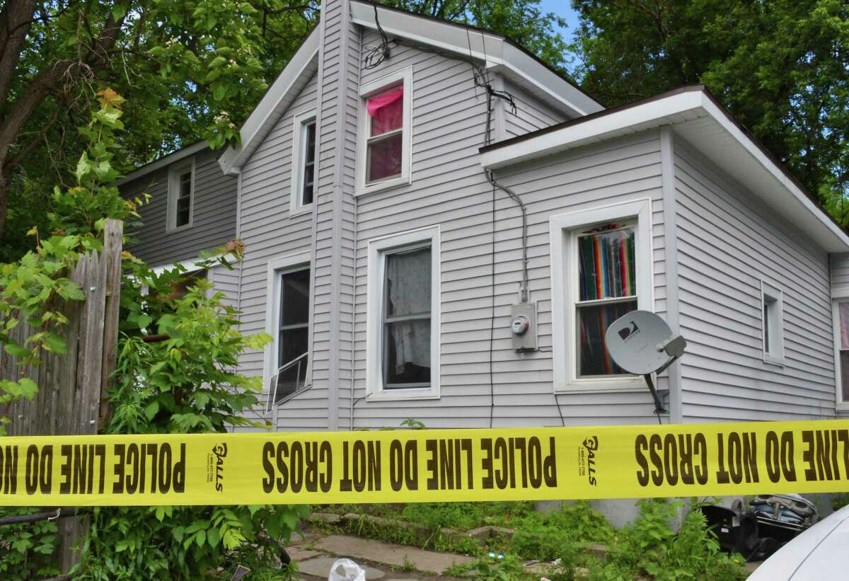 Police tape cordons off 8 Keating Avenue in Fort Edward Wednesday, June 6, 2012. Authorities say Gary Cota, 13, died in an accidental shooting in the house. (John Carl D'Annibale / Times Union)