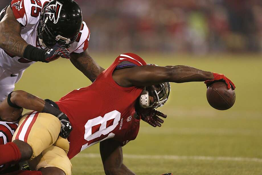 San Francisco 49ers wide receiver Anquan Boldin (81) reaches for extra yardage against the Atlanta Falcons on Monday, Dec. 23, 2013 at Candlestick Park in San Francisco, Calif. Photo: Beck Diefenbach, For The Chronicle