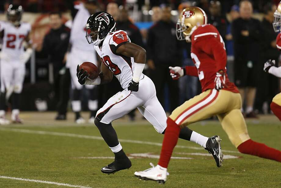 Atlanta Falcons wide receiver Drew Davis (19) evades San Francisco 49ers defenders during the second quarter of the game between the San Francisco 49ers and Atlanta Falcons at Candlestick Park on Monday December 23, 2013 in San Francisco, Calif.  The play resulted in a 59 yard gain. Photo: Michael Macor, The Chronicle