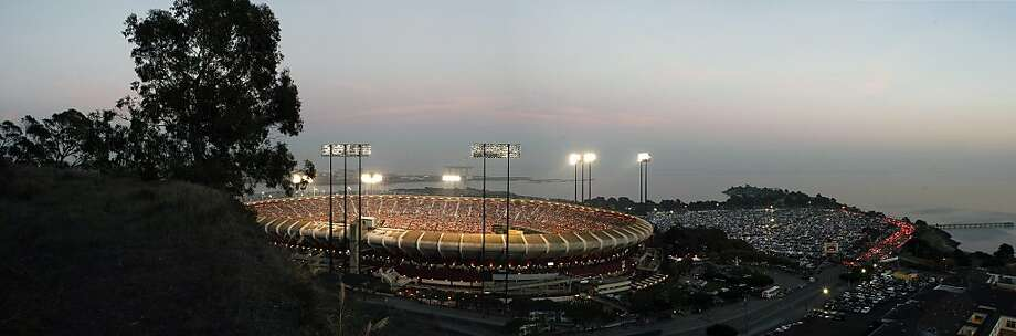 In this composite image made from four separate frames, Candlestick Park is seen illuminated on Monday, Dec. 23, 2013, in San Francisco, Calif.  The San Francisco 49ers and Atlanta Falcons play tonight in the last football game at Candlestick. Photo: Michael Short, The Chronicle