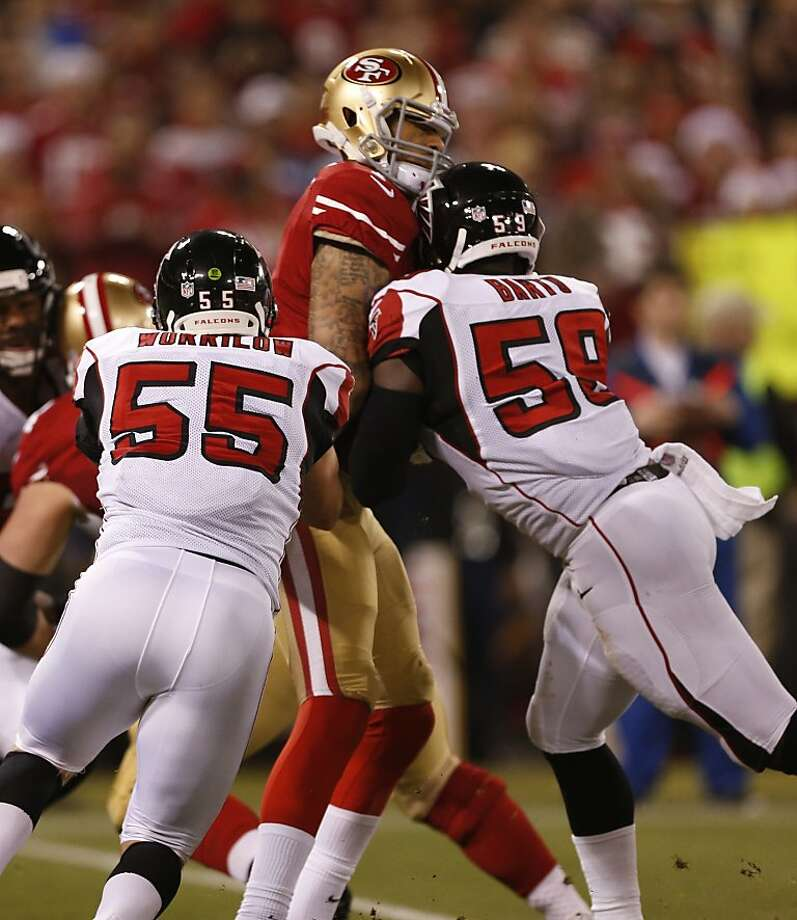 San Francisco 49ers quarterback Colin Kaepernick (7) takes a hit after unloading a pass during the first quarter against the Atlanta Falcons at Candlestick Park on Monday, Dec. 23, 2013 in San Francisco, Calif. Photo: Beck Diefenbach, For The Chronicle
