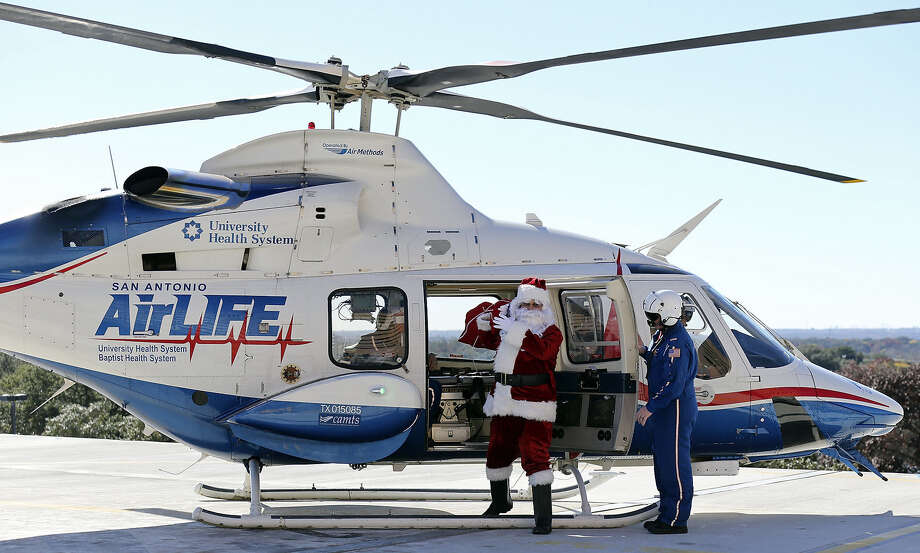 Santa doesn't always arrive by sleigh.  On Monday, when he brought gifts and good cheer to pediatric patients at University  Hospital, he and his bag that he filled with teddy bears, part of the hospital's Teddy  Bears for Tykes campaign, arrived in an AirLIFE helicopter ambulance. The bears were sponsored  by people who donated blood at the University Hospital Blood Bank this season. Photo: Edward A. Ornelas, San Antonio Express-News / © 2013 San Antonio Express-News