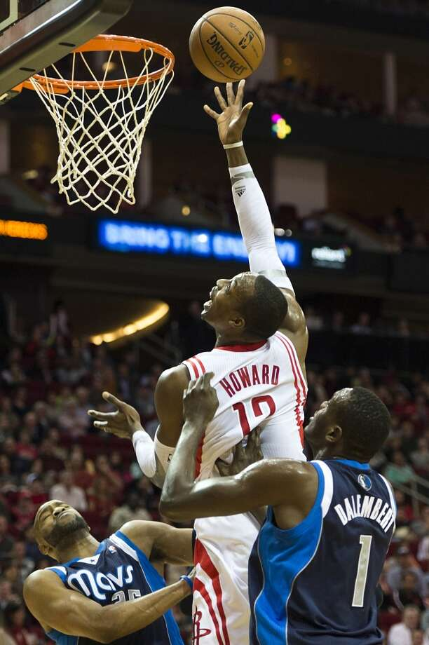 Dwight Howard scores over Mavericks center Samuel Dalembert. Photo: Smiley N. Pool, Houston Chronicle