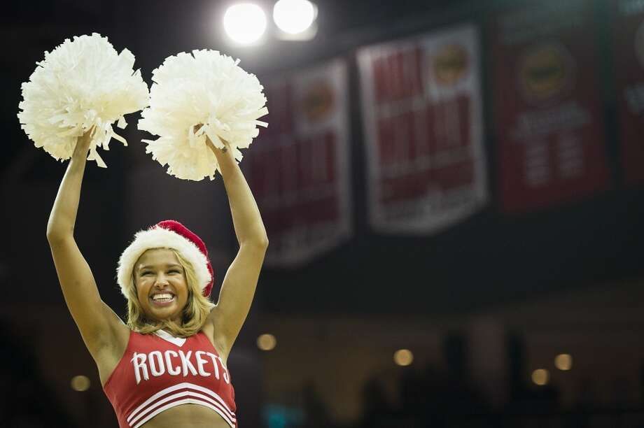 Members of Rockets Launch Crew wear Santa hats as they perform. Photo: Smiley N. Pool, Houston Chronicle