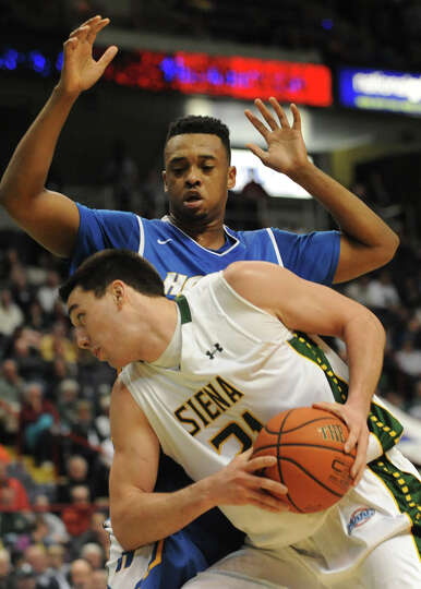 Siena's Brett Bisping is guarded by Hofstra's Zeke Upshaw  during a basketball game at the Times Uni