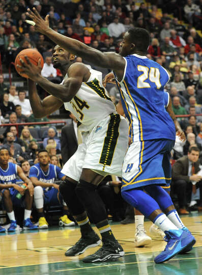 Siena's Imoh Silas is guarded by Hofstra's Stephen Nwaukoni during a basketball game at the Times Un