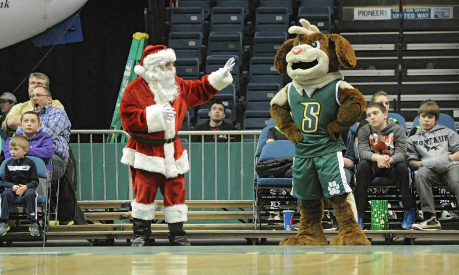 Saint Nick waves at the Siena Saint Bernard mascot during a basketball game against Hofstra at the Times Union Center on Monday, Dec. 23, 2013 in Albany, N.Y. (Lori Van Buren / Times Union) Photo: Lori Van Buren / 00025111A