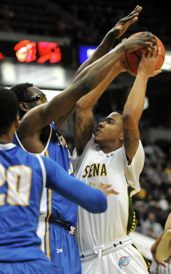 Siena's Marquis Wright is defended by Hofstra's Moussa Kone as he tries to make a shot during a basketball game at the Times Union Center on Monday, Dec. 23, 2013 in Albany, N.Y. (Lori Van Buren / Times Union) Photo: Lori Van Buren / 00025111A