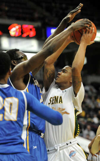 Siena's Marquis Wright is defended by Hofstra's Moussa Kone as he tries to make a shot during a bask