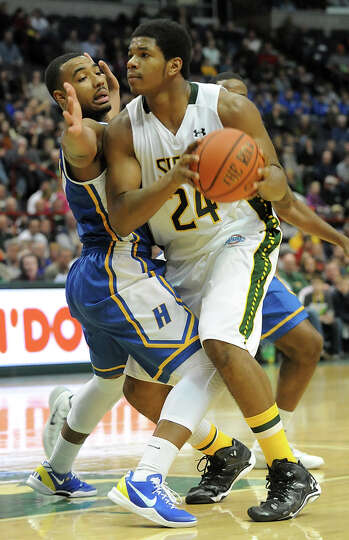 Siena's Lavon Long tries to drive around Hofstra's Dion Nesmith during a basketball game at the Time