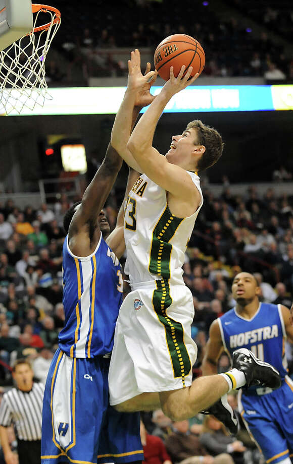 Siena's Rob Poole is fouled by Hofstra's Moussa Kone on shot that went in during a basketball game at the Times Union Center on Monday, Dec. 23, 2013 in Albany, N.Y. (Lori Van Buren / Times Union) Photo: Lori Van Buren / 00025111A