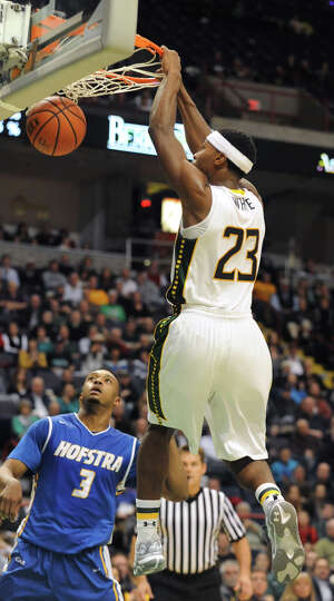Siena's Maurice White slam dunks the ball during a basketball game against Hofstra at the Times Unio