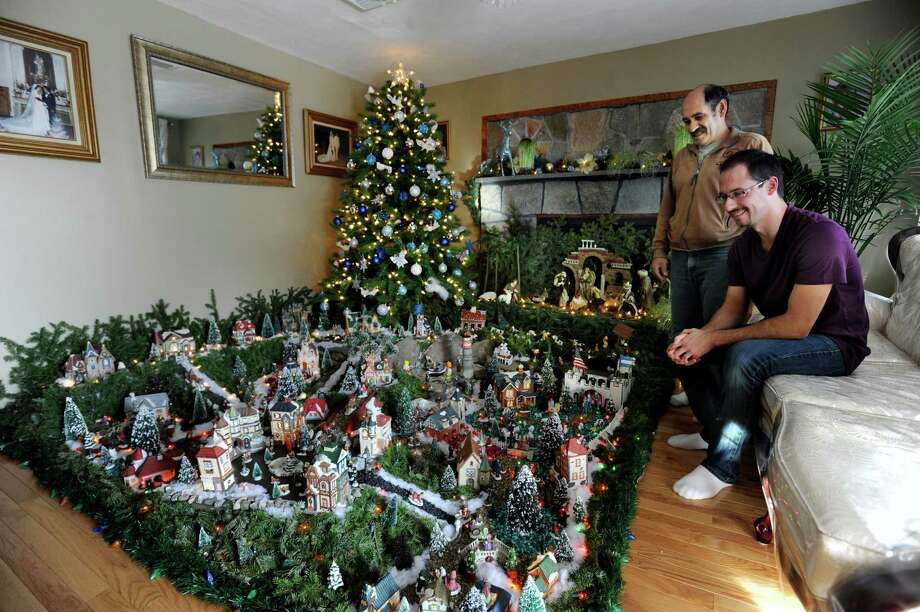 Luis Medeiros, 56, and his son Pedro Medeiro, 31, created this Christmas village that takes up most of the family's living room in Danbury, Conn., Thursday, Dec. 19, 2013. Photo: Carol Kaliff / The News-Times