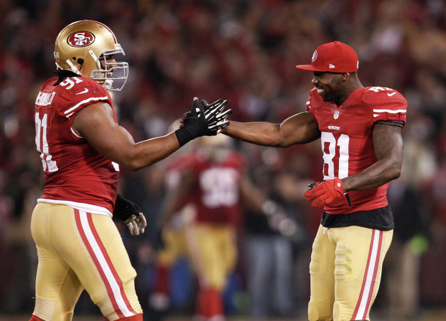 San Francisco 49ers wide receiver Anquan Boldin (81), right, and San Francisco 49ers defensive tackle Ray McDonald (91) congratulate each other after San Francisco 49ers linebacker NaVorro Bowman (53), not pictured, returned an interception eighty-nine yards for a touchdown during the fourth quarter of the game between the San Francisco 49ers and Atlanta Falcons at Candlestick Park on Monday December 23, 2013 in San Francisco, Calif. Photo: Michael Macor / The Chronicle / ONLINE_YES