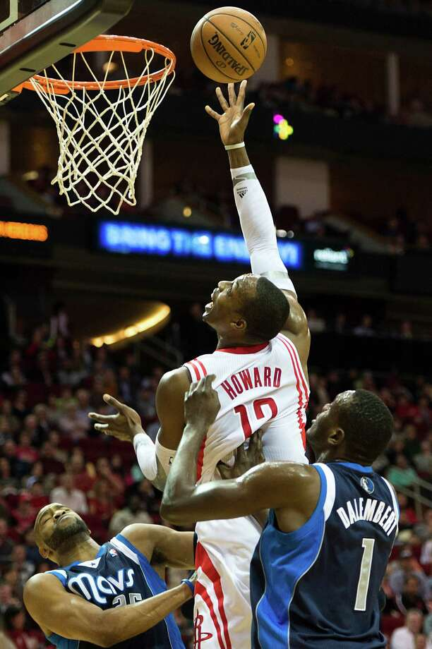 The offensive end of the court wasn't a problem for the Rockets as Dwight Howard, center, continued his recent surge with 29 points. But defense was another story. Photo: Smiley N. Pool, Staff / © 2013  Houston Chronicle