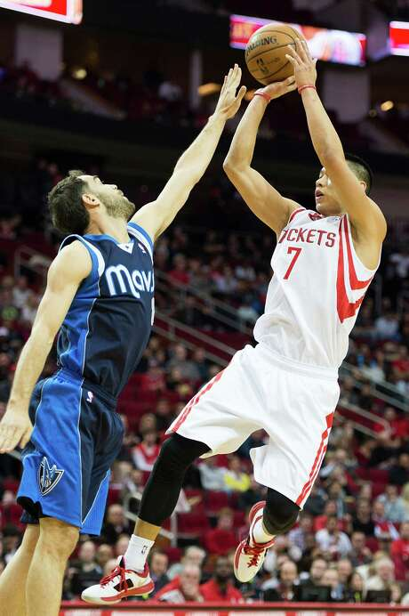 Rockets guard Jeremy Lin (7), hoisting a fallaway over Mavs guard Jose Calderon, thinks the team's shooting woes will eventually sort themselves out. Photo: Smiley N. Pool, Staff / © 2013  Houston Chronicle