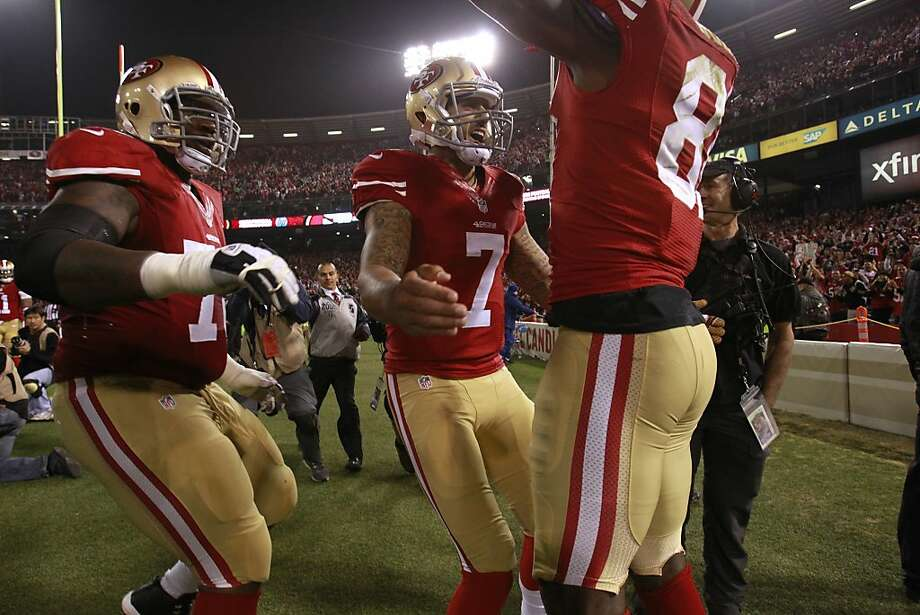 San Francisco 49ers quarterback Colin Kaepernick (7), middle, and offensive tackle Anthony Davis (76) celebrate Anquan Boldin's 3rd quarter touchdown on Monday, Dec. 23, 2013 in San Francisco, Calif., making the score 10-10 against the Atlanta Falcons. Photo: Beck Diefenbach, For The Chronicle