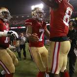 San Francisco 49ers quarterback Colin Kaepernick (7), middle, and offensive tackle Anthony Davis (76) celebrate Anquan Boldin's 3rd quarter touchdown on Monday, Dec. 23, 2013 in San Francisco, Calif., making the score 10-10 against the Atlanta Falcons.