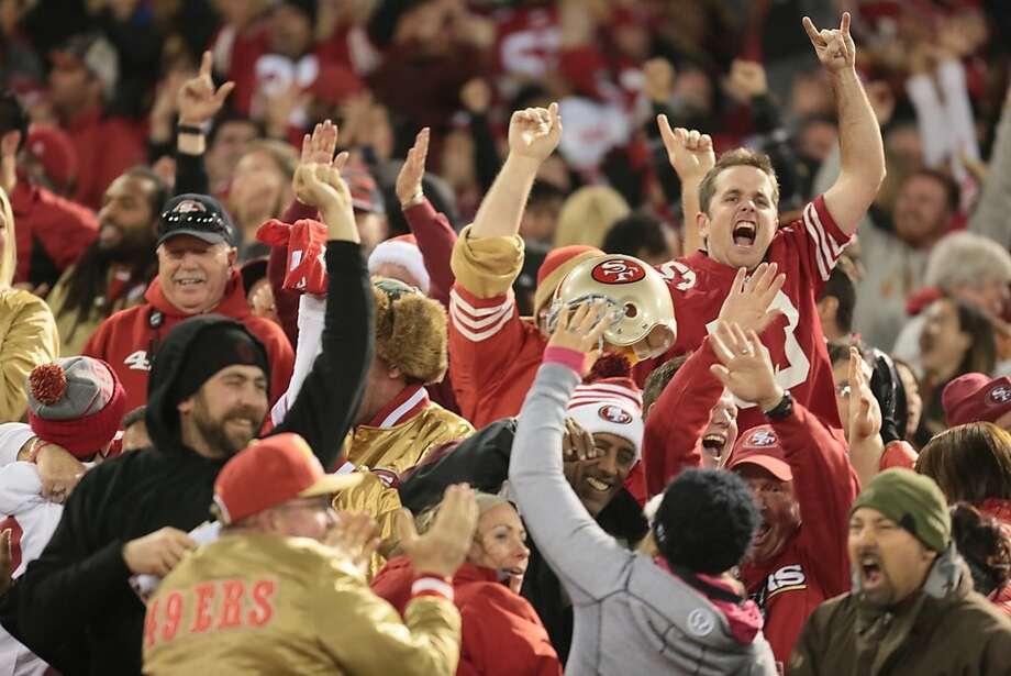 Fans celebrate San Francisco 49ers linebacker NaVorro Bowman's (53) 4th quarter touchdown against the Atlanta Falcons on Monday, Dec. 23, 2013 in San Francisco, Calif., making the score 34-24. Photo: John Storey, For The Chronicle