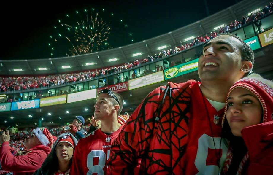 Fans enjoy the fireworks after the 49ers beat the Falcons  during the last game at Candlestick Park in San Francisco, Calif., on December 23rd, 2013. Photo: John Storey, Special To The Chronicle