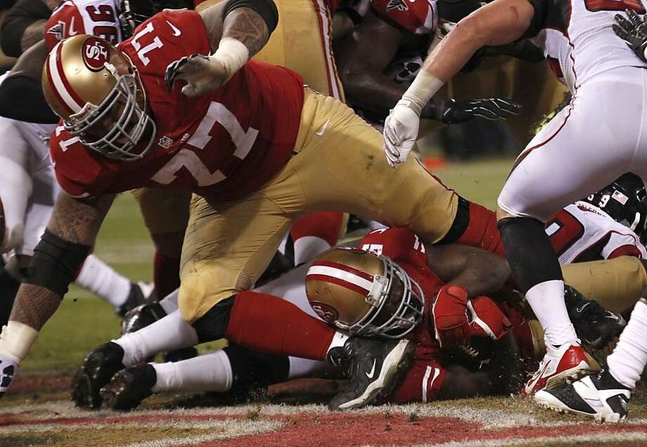 San Francisco 49ers running back Frank Gore (21) scores on a 1 yard run in the 4th quarter against the Atlanta Falcons on Monday, Dec. 23, 2013 in San Francisco, Calif. Photo: Beck Diefenbach, For The Chronicle