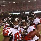 Atlanta Falcons wide receiver Roddy White (84), middle, celebrates his 39 yard touchdown with teammates Harry Douglas, left, and Harland Gunn against the 49ers on Monday, Dec. 23, 2013 in San Francisco, Calif.