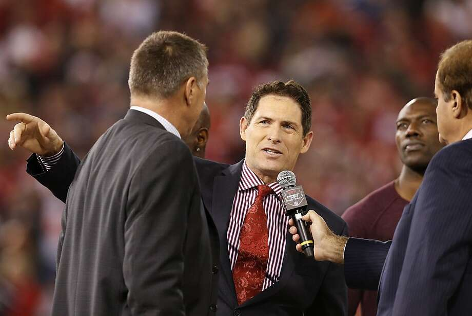 Former San Francisco 49ers quarterback Steve Young, center, speaks during a post-game ceremony after the game between the San Francisco 49ers and Atlanta Falcons at Candlestick Park on Monday December 23, 2013 in San Francisco, Calif.  The 49ers defeated the Falcons, 34-24, in the last home game the 49ers will have at Candlestick Park before the stadium is demolished. Photo: Michael Macor, The Chronicle