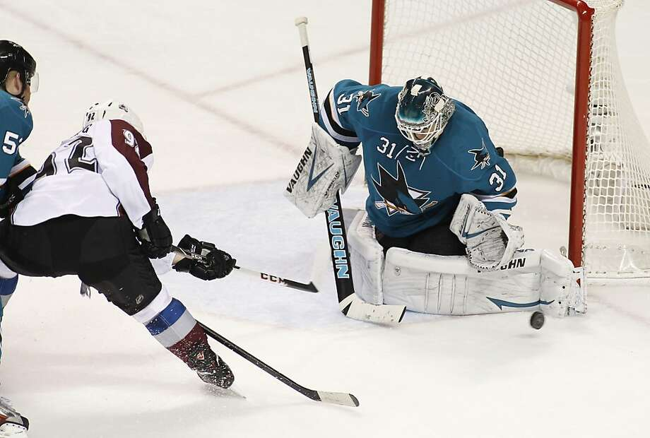 Sharks goalie Antti Niemi blocks a second-period shot by the Avalanche's Gabriel Landeskog as San Jose's Matt Irwin (left) helps defend. Photo: George Nikitin, Associated Press