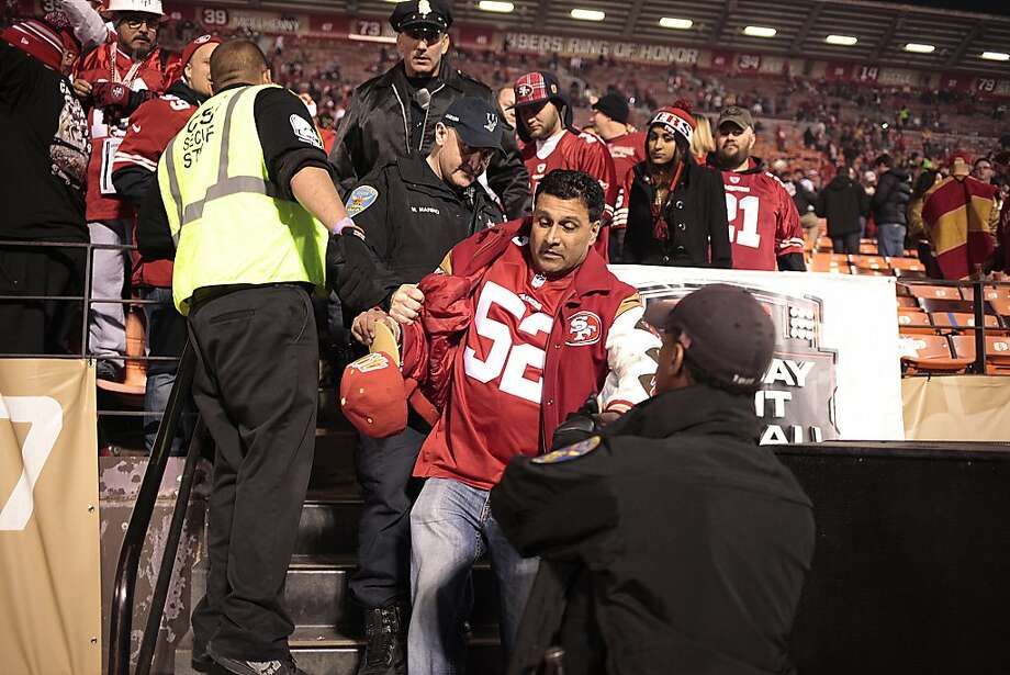 A fan is arrested at Candlestick Park after San Francisco 49ers last game at the park in San Francisco, Calif. on Monday Dec. 23, 2013.  The San Francisco 49ers hosted the Atlanta Falcons at one of their last games at Candlestick Park. Photo: James Tensuan, Special To The Chronicle