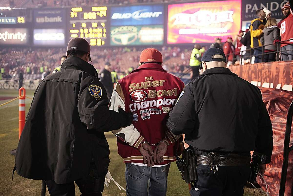 A fan is arrested at Candlestick Park after San Francisco 49ers last game at the park in San Francisco, Calif. on Monday Dec. 23, 2013. The San Francisco 49ers hosted the Atlanta Falcons at one of their last games at Candlestick Park.
