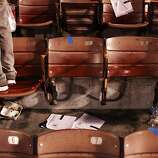 A fan stands next to two seats that were dismantled for souvenirs after a 49ers game against the Atlanta Falcons at Candlestick Park on December 23, 2013 in San Francisco, Calif. This will be the last regular-season game at Candlestick Park.