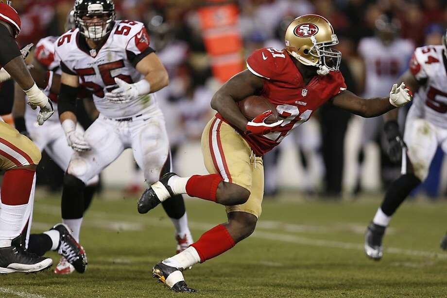 San Francisco 49ers running back Frank Gore (21) runs during the fourth quarter of the game between the San Francisco 49ers and Atlanta Falcons at Candlestick Park on Monday December 23, 2013 in San Francisco, Calif. Photo: Michael Macor, The Chronicle