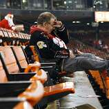 Richard Habib gets emotional as he sits in his seat after the San Francisco 49ers defeated the Atlanta Falcons during a Monday Night Football game which will be the last regular season game to be held at Candlestick Park in San Francisco, CA, Monday, December 23, 2013.
