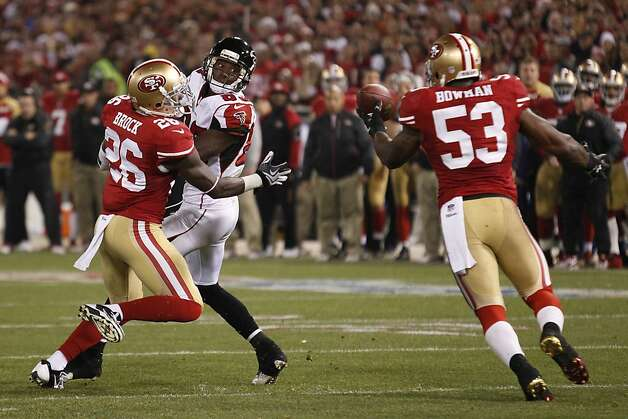 NaVorro Bowman snares a Matt Ryan pass deflected by Tramaine Brock. Bowman turned the interception into a game-clinching 89-yard touchdown return. Photo: Beck Diefenbach, For The Chronicle