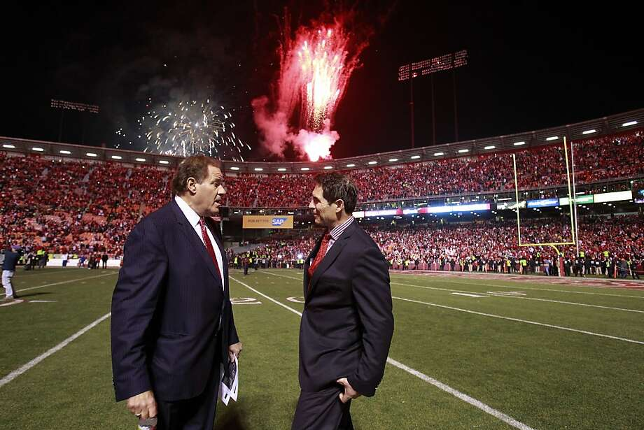 Former 49ers player Steve Young (right) and commentator Chris Berman talk during farewell fireworks following the game, Monday, December 23, 2013 in San Francisco, Calif. Photo: Beck Diefenbach, Special To The Chronicle